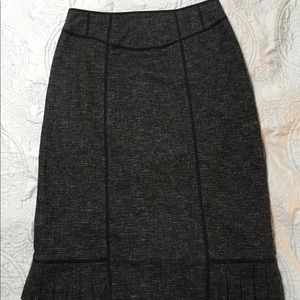 Flirty black tweed-like pencil skirt w/pleated hem